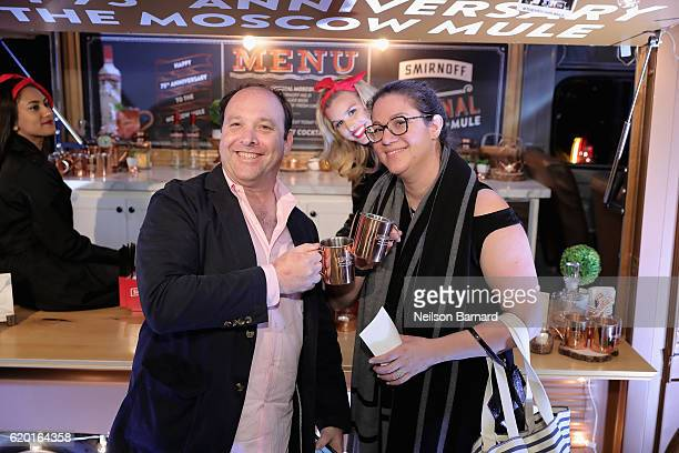 Guests pose with their complimentary Smirnoff Moscow Mule Mugs in front of the Smirnoff Copper Truck during the 2016 New York Taste presented by Citi...