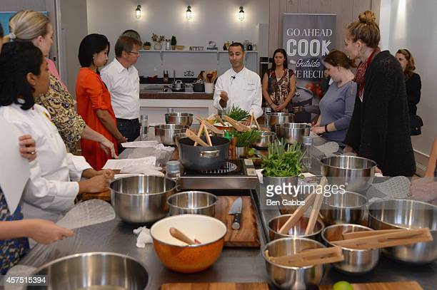 Guests prepare food with chef Nima Khansari at the Anolon Cookware Presents Classic Canapes With Great Performances Part Of The Artisanal Cooking...