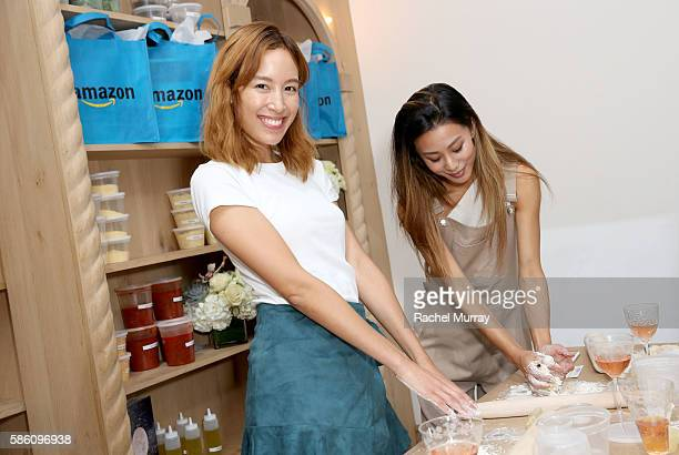 Guests Rachel Nyugen That's Chic and Jenny Ong Neon Blush make pizza during Katherine Schwarzenegger's Amazon Echo cooking class at AU FUDGE on...