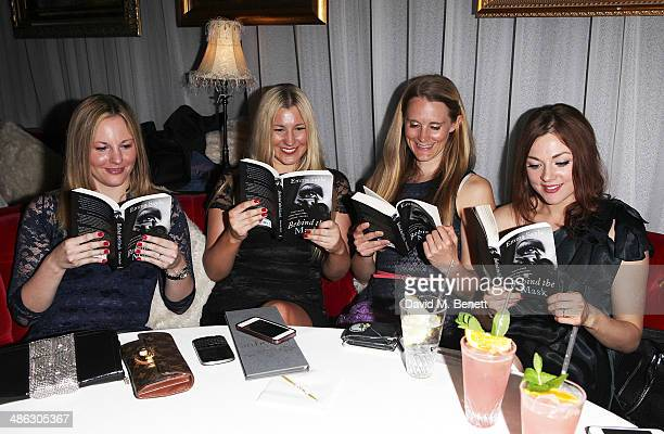 Guests read the book at the launch of 'Behind The Mask' by Killing Kittens founder Emma Sayle at Salvatore's Baroque at The Playboy Club on April 23...