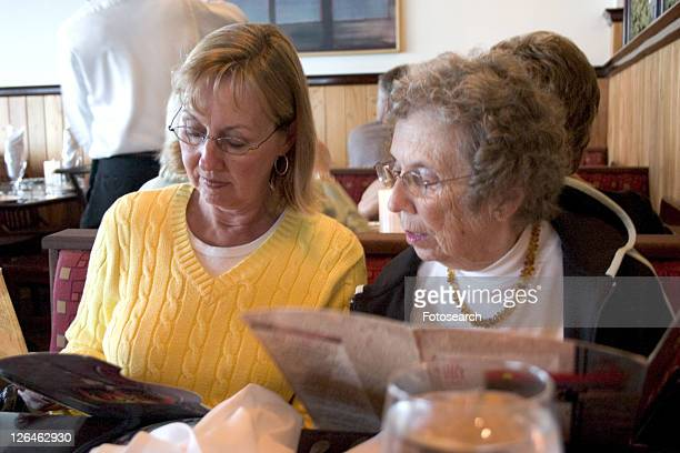 Guests reading a menu