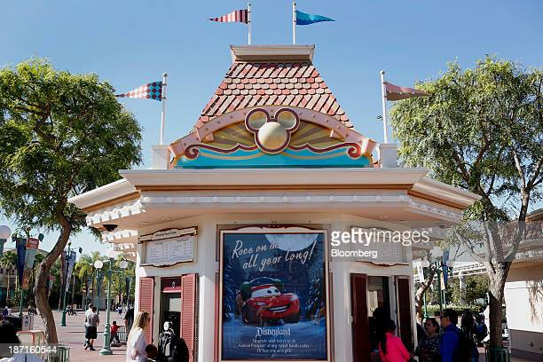 Guests receive tickets at Walt Disney Co's Disneyland Park part of the Disneyland Resort in Anaheim California US on Wednesday Nov 6 2013 The Walt...