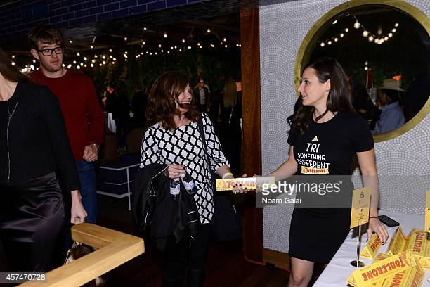 Guests receive Toblerone chocolate bars at Ample Hills Brooklyn's Best Dessert Party during the Food Network New York City Wine Food Festival...