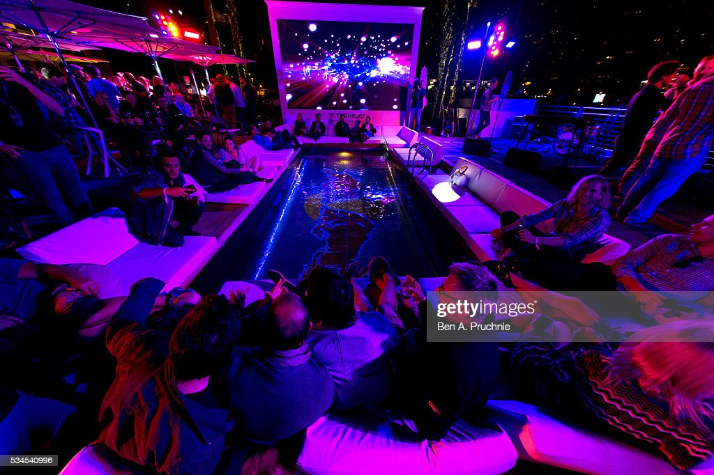 Guests relax by the pool at the Red Bull Racing Energy Station at Monte Carlo on May 26, 2016 in Monaco.