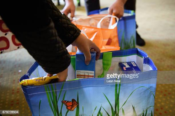Guests repack items at Wandsworth foodbank from their parcels of donated food toiletries and other items on May 5 2017 in London England The Trussell...