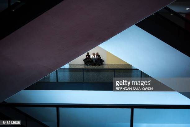 Guests rest near escalators at the Hirshhorn Museum February 21 2017 in Washington DC / AFP / Brendan Smialowski