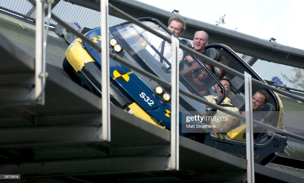 Guests ride the Test Track at Walt Disney World's Epcot October 8 2003 near Orlando Florida