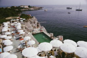 Guests round the swimming pool at the Hotel du Cap EdenRoc Antibes France August 1969