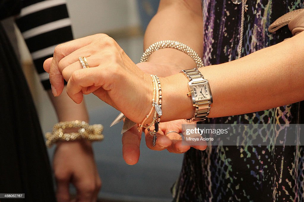 Guests sample bracelets from Same Sky at the Ethical Shopping Event hosted by Reem Acra at Reem Acra on December 19, 2013 in New York City.