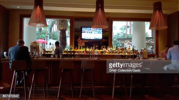 Guests sit in a bar area at Mandalay Bay Resort and Casino in Las Vegas Nevada 2016
