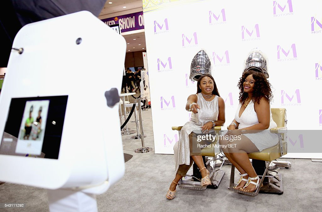 Guests sit in the photobooth at Fashion And Beauty @BETX presented by Progressive, Covergirl, Strength of Nature, Korbel and Macy's during the 2016 BET Experience on June 25, 2016 in Los Angeles, California.