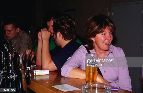 Guests sitting at bar of B72 Gurtel bar, Josefstadt.