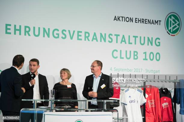 Guests speak as they attend the Awarding Ceremony at the 20th anniversary of Volunteering for the Club 100 at MercedesBenz Museum on September 4 2017...