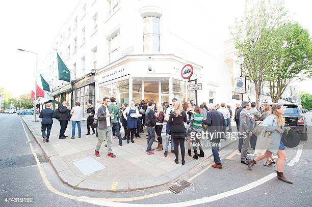 Guests spill out onto the street at the launch of The Dot Project group show 'Distorted Vision' on May 21 2015 in London England