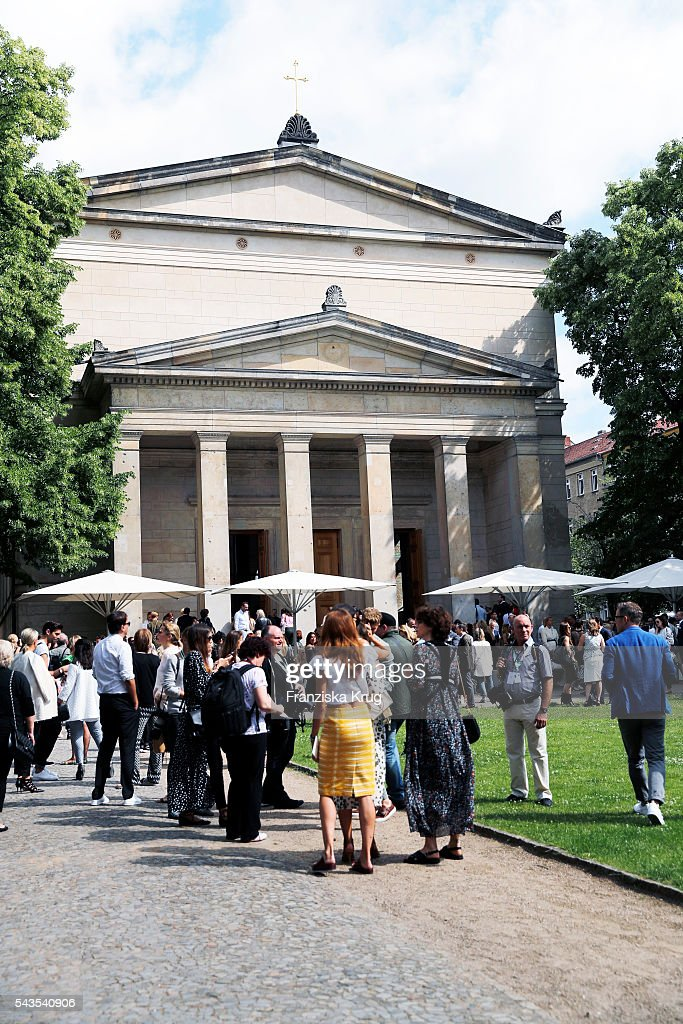 Guests stand in front of the venue ahead of the Dorothee Schumacher show during the Mercedes-Benz Fashion Week Berlin Spring/Summer 2017 at Elisabethkirche on June 29, 2016 in Berlin, Germany.