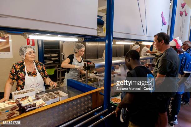 Guests stand inline to the Caritas canteen at Colle Oppio in Rome on the midAugust holiday on August 15 2017 in Rome Italy Caritas canteen of Colle...
