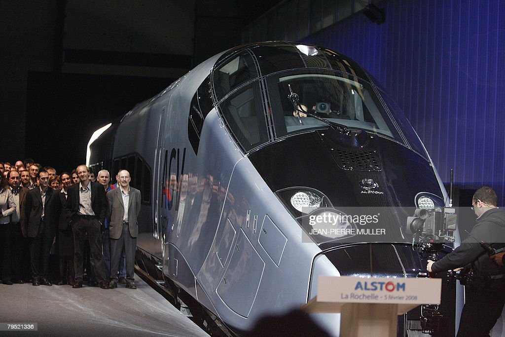 Guests stand next to Alstom's new highspeed AGV during the train's first presentation in La Rochelle western France February 05 2008 The French...