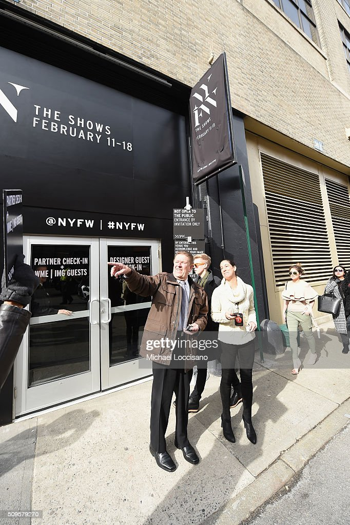 Guests stand outside Fall 2016 New York Fashion Week at the Skylight at Clarkson sq on February 11, 2016 in New York City.