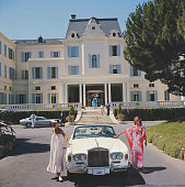Guests standing by a white RollsRoyce convertible courtesy car at the Hotel du Cap EdenRoc Antibes France August 1976
