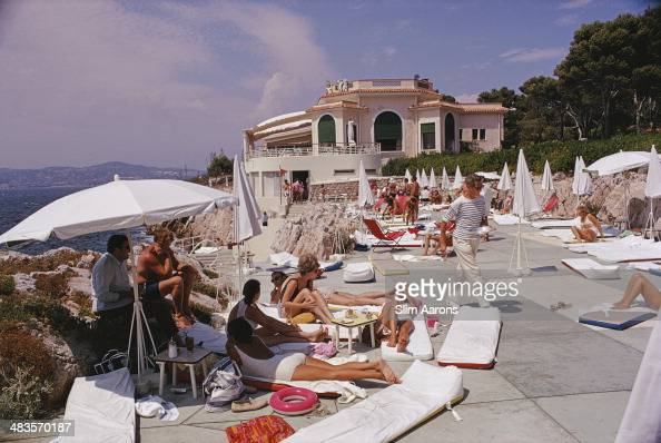 Guests sunbathing on a terrace at the Hotel du CapEdenRoc in Antibes on the French Riviera August 1969