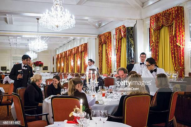 Guests take a dinner at the luxury Kulm Hotel on December 14 2013 in St Moritz EngadinGraubunden Switzerland
