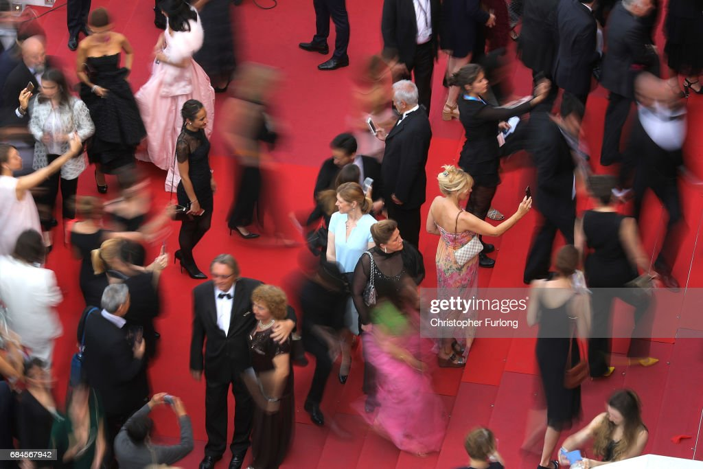 Guests take selfies as they arrive for the screening of 'Loveless (Nelyubov)' screening during the 70th annual Cannes Film Festival at Palais des Festivals on May 18, 2017 in Cannes, France.