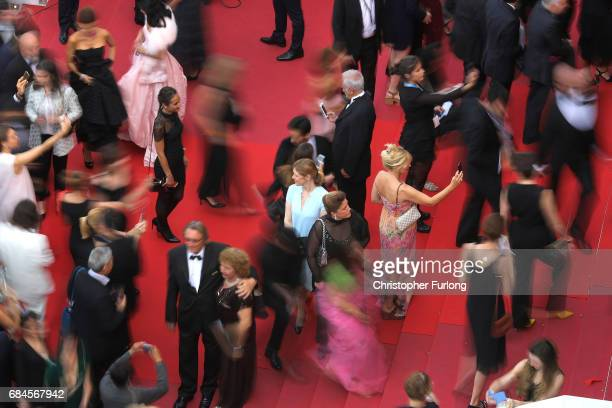 Guests take selfies as they arrive for the screening of 'Loveless ' screening during the 70th annual Cannes Film Festival at Palais des Festivals on...