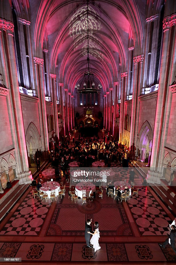 Guests take to the dance floor during the Queen Charlotte's Ball at the Royal Courts of Justice on October 26, 2013 in London, England. Queen Charlotte's Ball is the pinnacle event in the London Season. The London Season is rich in history and was formed over two hundred years ago when the custom of returning to London at the end of the hunting season was celebrated with glittering balls and high society events. The modern group of meticulously selected debutantes continue the tradition and celebrate their year of charity fund raising, etiquette classes and debut at The Queen Charlotte's Ball. The young ladies, usually aged between 17 and 20 and wearing designer dresses, attend the grand ball where they are presented to guests and curtsey to the Queen Charlotte Cake. King George III introduced the Queen Charlotte's Ball in 1780 to celebrate his wife's birthday and debutantes were traditionally presented to the King or Queen until 1958.