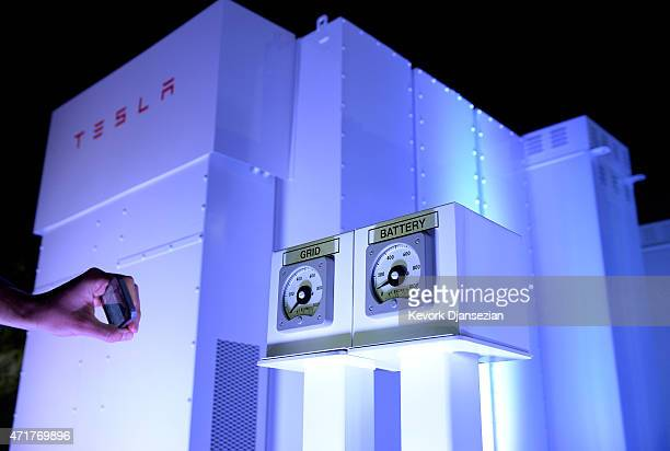 A guests takes photographs of the Powerpack system after Elon Musk CEO of Tesla unveiled suit of batteries for homes businesses and utilities at...