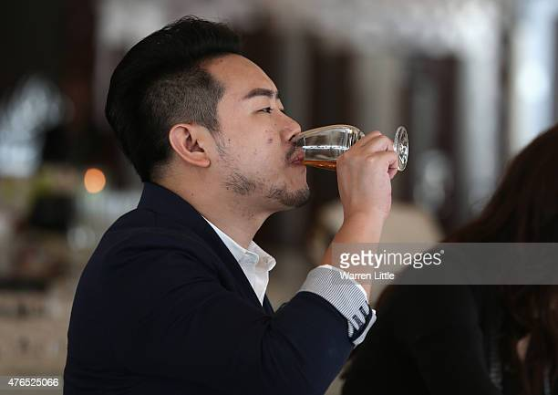 A guests tastes whisky as Chivas Regal launches the pinnacle of its range Chivas Regal The Icon at The One Only Royal Mirage on June 9 2015 in Dubai...