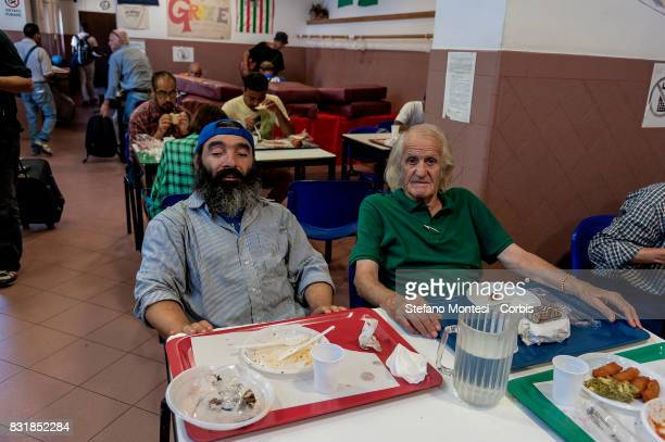 Guests to the Caritas canteen at Colle Oppio in Rome on the midAugust holiday on August 15 2017 in Rome Italy Caritas canteen of Colle Oppio provide...