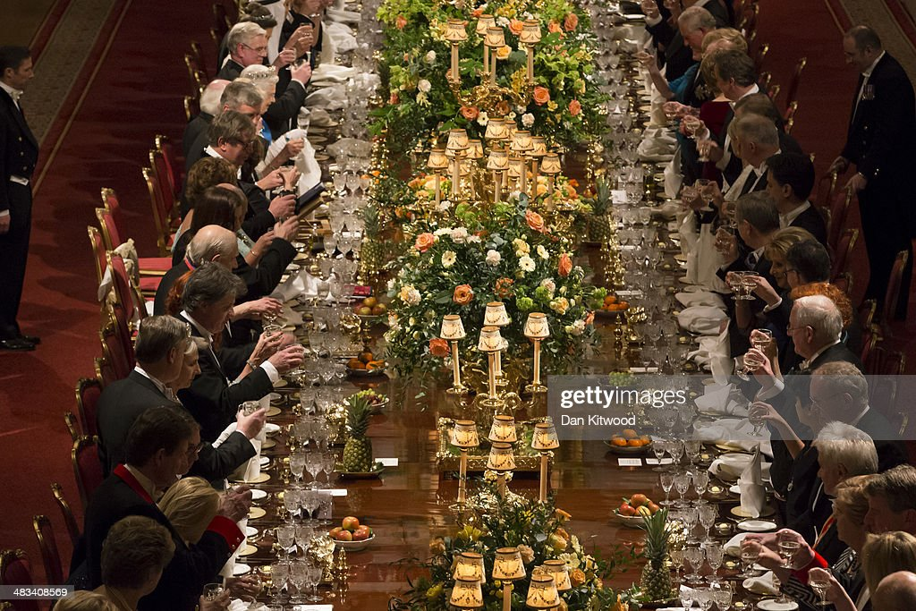 Guests toast after a speech by Queen <a gi-track='captionPersonalityLinkClicked' href=/galleries/search?phrase=Elizabeth+II&family=editorial&specificpeople=67226 ng-click='$event.stopPropagation()'>Elizabeth II</a> and the President of Ireland Michael D. Higgins on April 8, 2014 in Windsor, England. Guests and dignitaries including Irish prime minister, Enda Kenny and Northern Ireland's deputy first minister Martin McGuinness attending the banquet at the end of the first day of a state visit by Ireland's Michael D. Higgins. Ireland's Michael D. Higgins is making the first state visit by a president of the republic since it gained independence from neighbouring Britain. The visit comes three years after Queen <a gi-track='captionPersonalityLinkClicked' href=/galleries/search?phrase=Elizabeth+II&family=editorial&specificpeople=67226 ng-click='$event.stopPropagation()'>Elizabeth II</a> made a groundbreaking trip to the republic, which helped to heal deep-rooted unease and put British-Irish relations on a new footing. Higgins' return visit will be seen as an official sign of further progress following the hard-won peace in Northern Ireland, which remains part of the United Kingdom.