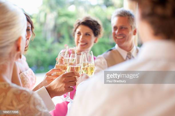 Guests toasting with champagne at wedding reception