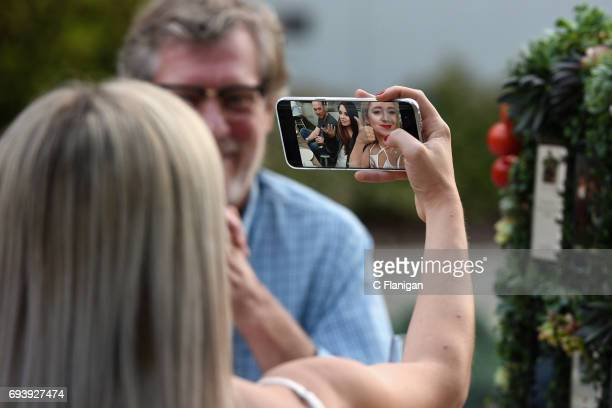 Guests try out the new Samsung Galaxy S8 during the Samsung Women in Country x Change The Conversation Dinner on June 8 2017 at Henrietta Red in...