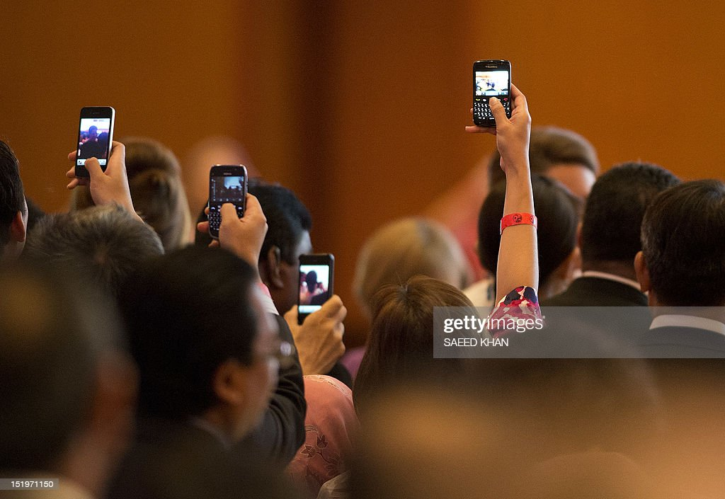 Guests try to get pictures of Britain's Prince William's wife Catherine, the Duchess of Cambridge at a business luncheon by the British Malaysia Chamber of Commerce at KLCC in Kuala Lumpur on September 14, 2012, on the second leg of a nine-day Southeast Asian and Pacific tour marking Queen Elizabeth II's Diamond Jubilee. AFP PHOTO / Saeed KHAN