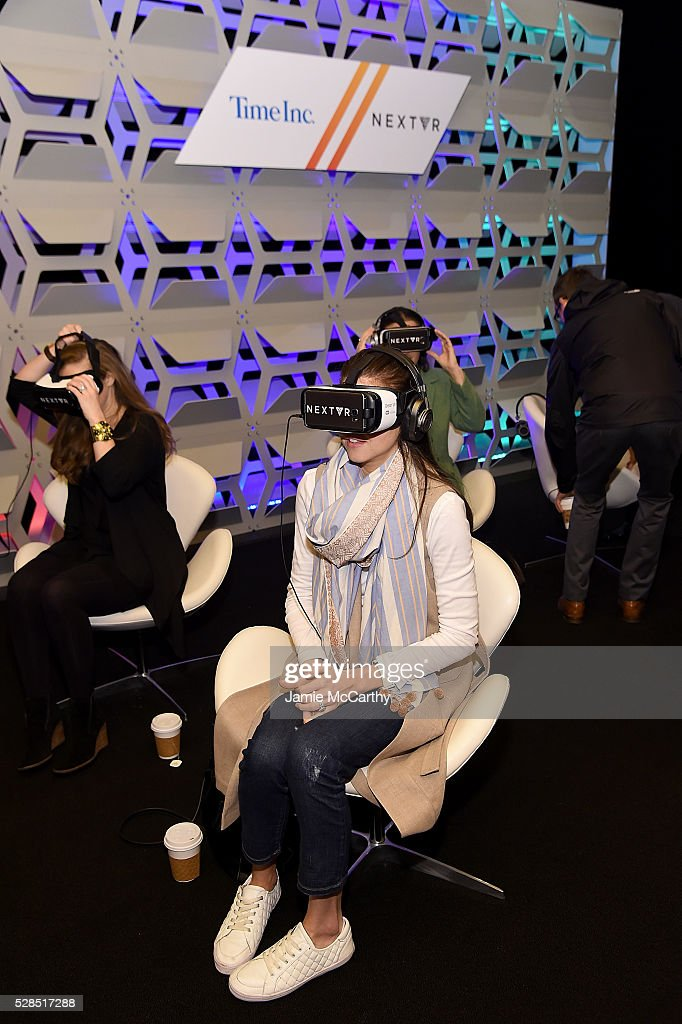 Guests use VR helmets during the TimeInc. NEWFRONT at Gotham Hall on May 5, 2016 in New York City.