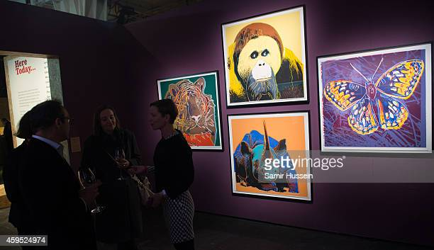 Guests view Andy Warhol's 'Endangered Species Portfolio' at the exclusive preview of the art exhibition 'Here Today' to celebrate the 50th...