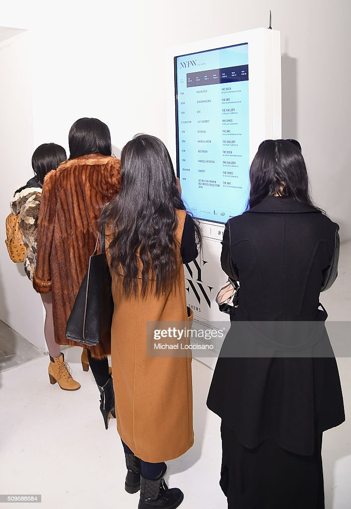 Guests view display at New York Fashion Week Fall 2016 at Clarkson Sq on February 12, 2016 in New York City.
