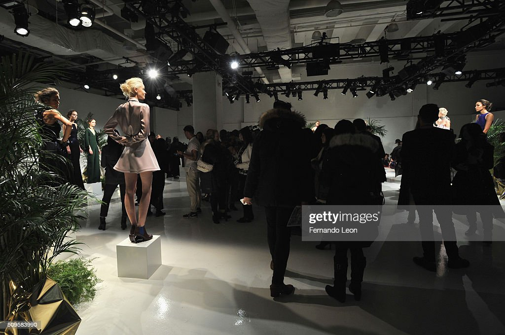 Guests view models wearing Jay Godfrey Fall 2016 during New York Fashion Week: The Shows at The Space, Skylight at Clarkson Square on February 11, 2016 in New York City.