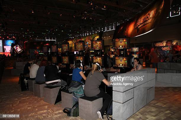 Guests visit fair booths at the games fair 'Gamescom' in Cologne Germany on August 17 2016 Computer games fair will be open from 17 until 21th of...