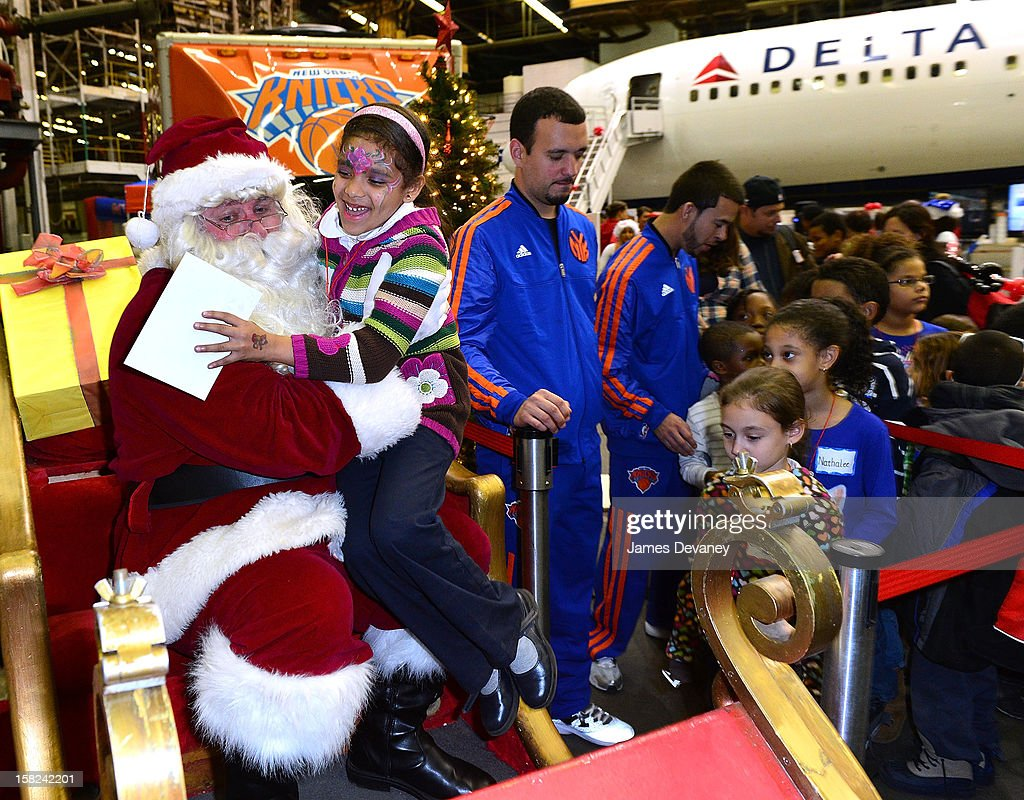 Guests visit Santa at the 3rd Annual Garden of Dreams Foundation & Delta Air Lines' 'Holiday in the Hangar' event at John F. Kennedy International Airport on December 11, 2012 in New York City.