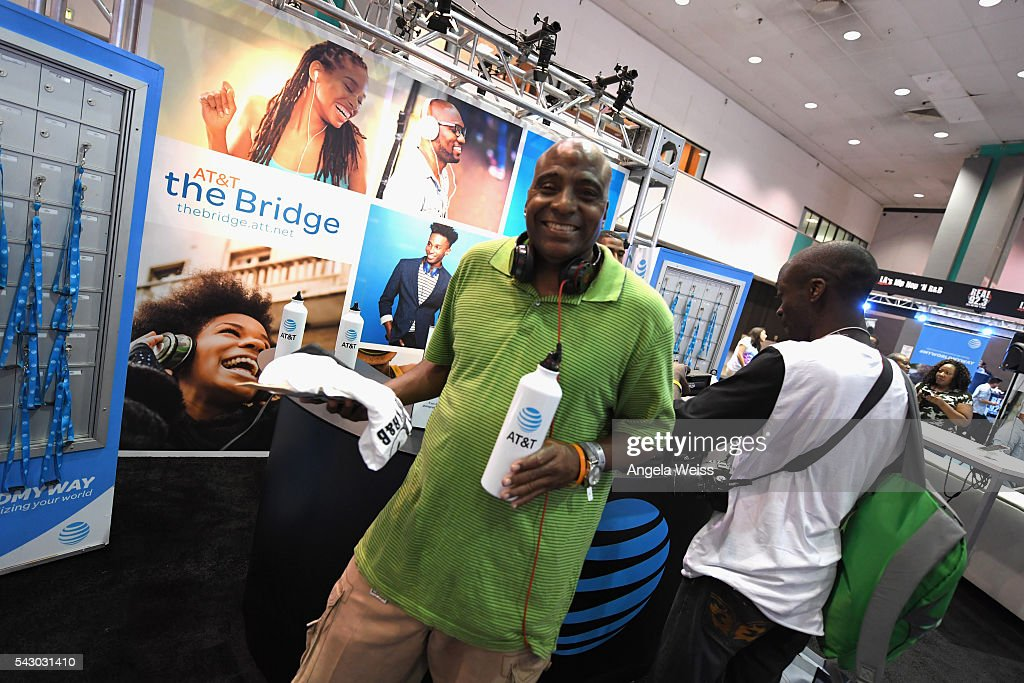 Guests visit the AT&T booth at FAN FEST during the 2016 BET Experience on June 25, 2016 in Los Angeles, California.