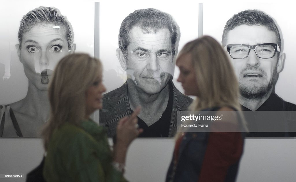 Guests visit the Hormiguero's Tv Show 'Dark Man' Photography Exhibition on it's opening day at El Corte Ingles Store on December 14, 2012 in Madrid, Spain.