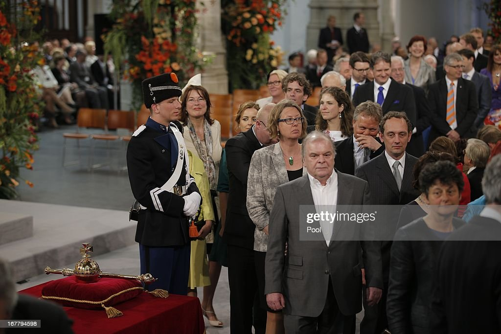 Guests walk by the regalia (Crown, Sceptre, Globus Cruciger and Sword of State) as they arrive to attend the inauguration of HM King Willem Alexander of the Netherlands and HRH Princess Beatrix of the Netherlands at New Church on April 30, 2013 in Amsterdam, Netherlands.