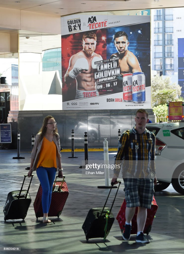 Guests walk into MGM Grand Hotel & Casino in front of a poster advertising the fight between WBC, WBA and IBF middleweight champion Gennady Golovkin and Canelo Alvarez on September 12, 2017 in Las Vegas, Nevada. Golovkin will defend his titles against Alvarez at T-Mobile Arena on September 16 in Las Vegas.