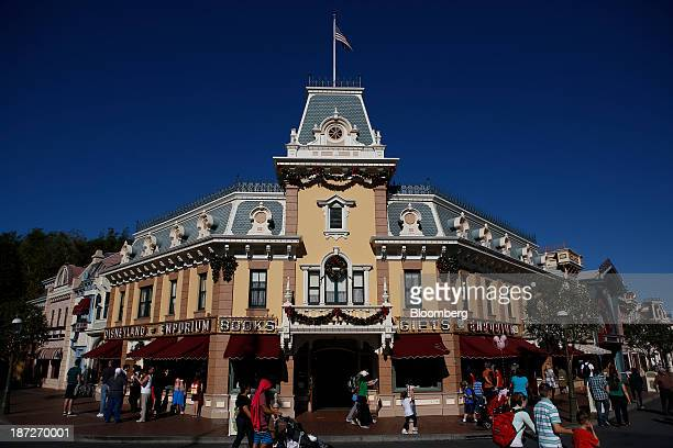 Guests walk past the Disneyland Emporium gift shop on Main Street USA at Walt Disney Co's Disneyland Park part of the Disneyland Resort in Anaheim...