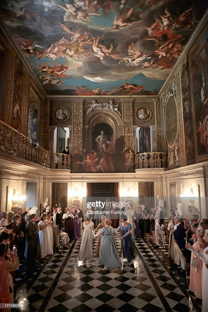 Guests watch a display of regency dancing during the Pride and Prejudice Ball in the painted hall of Chatsworth House on June 22, 2013 in Chatsworth, England. To celebrate the 200th anniversary of the publication of Jane Austen's Pride and Prejudice Chatsworth stately home staged a regency costume evening. Chatsworth House is believed to be the inspiration for Pemberley, the residence of Mr. Darcy. Austen based her idea of Pemberley on Chatsworth House as she wrote the novel in nearby Bakewell in 1812. Chatsworth also featured in the 2005 Pride and Prejudice movie starring Keira Knightley
