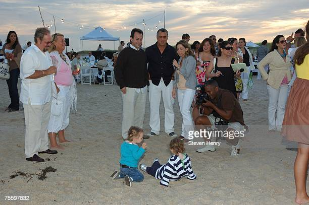 Guests watch as children play on the beach at the Hamptons Magazine Gotham Magazine's Annual Clambake on July 22 2007 in Southampton New York