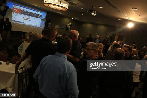 Guests watch as results are posted on tv during the Republican Greg Gianforte's election party as Gianforte takes a slight lead and guests wait to...