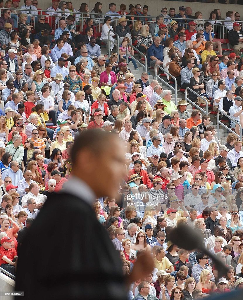 Guests watch as US President <a gi-track='captionPersonalityLinkClicked' href=/galleries/search?phrase=Barack+Obama&family=editorial&specificpeople=203260 ng-click='$event.stopPropagation()'>Barack Obama</a> delivers the commencement address during a ceremony at Ohio State University on May 5, 2013 in Columbus, Ohio. AFP PHOTO/Mandel NGAN